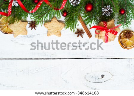 Christmas baking concept -  some cookies, fir tree brunches and decorations. Top view, copy space