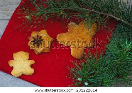 christmas baking gingerbread cookies old wooden table and fir background
