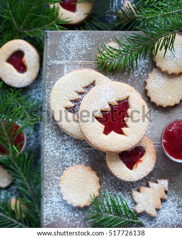 Christmas baking. Homemade cookies with strawberry jam in the form of Christmas trees on a wooden background. Christmas food. New Year card. Rustic style. Country style. Beautiful Christmas card