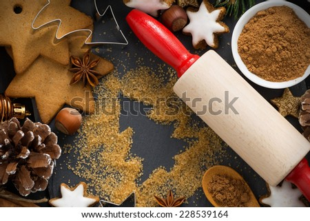 Christmas baking - ingredients and cookies, horizontal, top view, close-up - stock photo