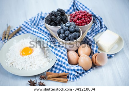 Christmas baking. Ingredients for the preparation of berry pie. - stock photo