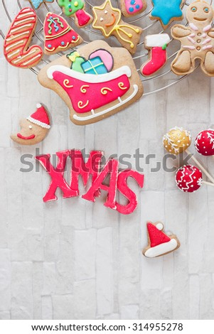 Christmas baking. Various types of Christmas decorative cookies decorated with sugar icing on cooling rack  - stock photo