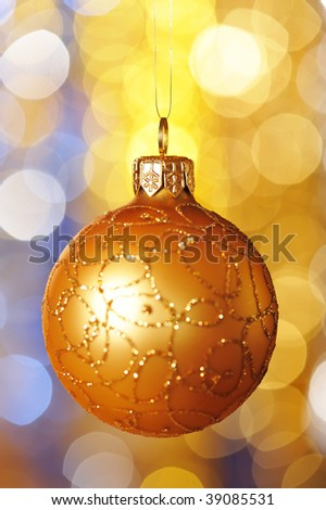 Christmas ball against defocused background with shallow depth of field