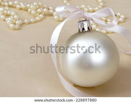 Christmas ball and beads. - stock photo