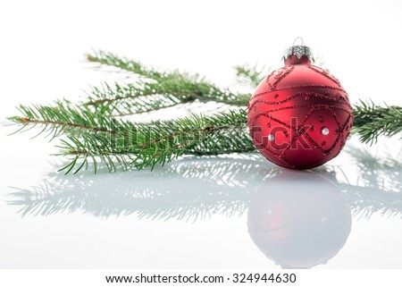 Christmas ball and green fir tree, on white background - stock photo