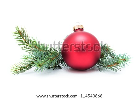 Christmas ball and green spruce branch, isolated white background - stock photo