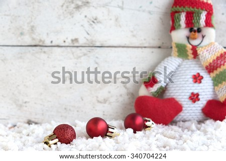 christmas ball and snowman on the snow in vintage background