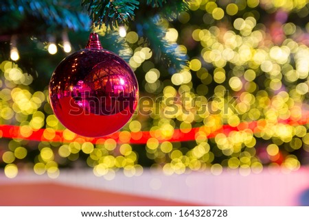 Christmas ball decoration against lights blurred background - stock photo