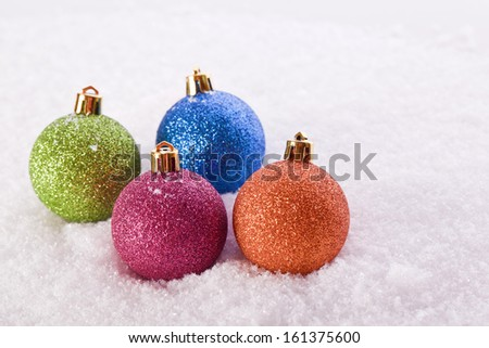 christmas ball decoration in the snow