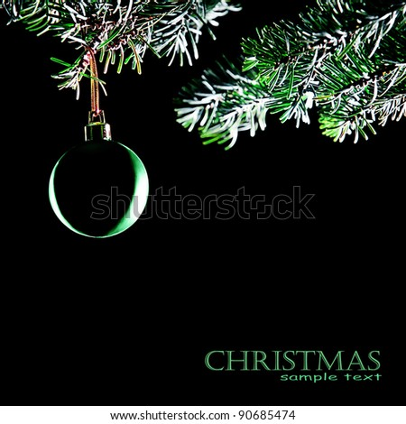 Christmas ball. Decoration xmas tree branch with bauble isolated on black background - stock photo