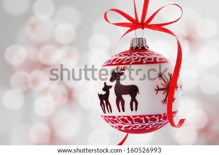 christmas ball hanging in front of an abstract background