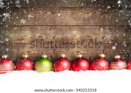 christmas ball in the snow - stock photo