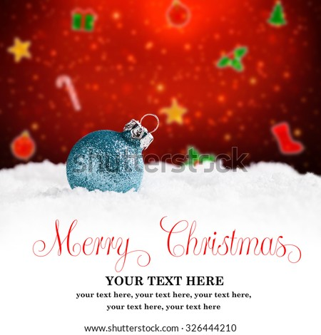 christmas ball in the snow with merry christmas greeting and sample text - stock photo
