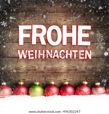 christmas ball in the snow with merry christmas greeting (in German)