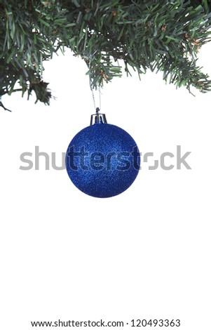 christmas ball on a fir tree close up white background