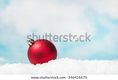 Christmas ball on a table in the snow - stock photo