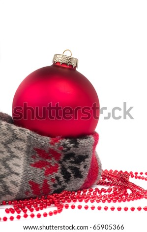 Christmas ball  on scarf isolated on white