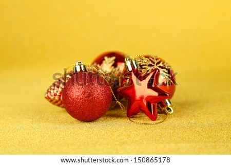 Christmas balls and decor gift on yellow background