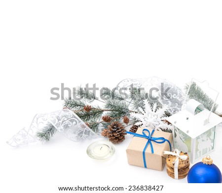 Christmas balls and fir branch on white background