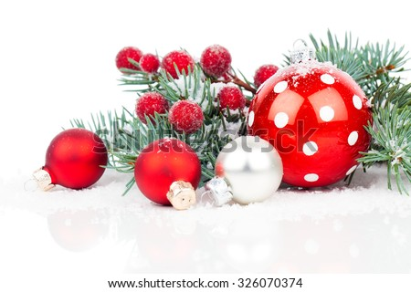 Christmas balls and fir branches with decorations isolated over white - stock photo