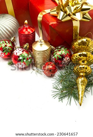 Christmas balls and fir branches with Gifts and Candles  isolated on white
