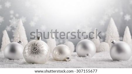 Christmas balls and fir tree on snow