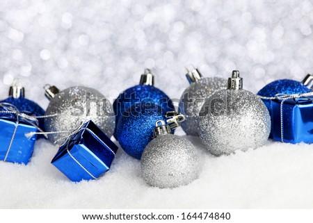 Christmas balls and gifts on snow - stock photo