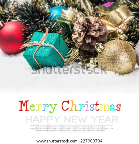 Christmas balls and gifts under the Christmas tree with place for your congratulations - stock photo