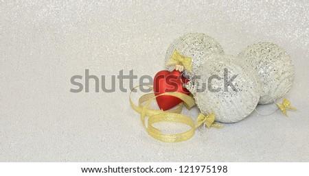 Christmas balls and gold ribbon - stock photo