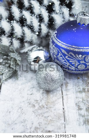 Christmas balls and snowflake on wooden background. - stock photo