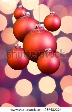 christmas balls before a twinkle background - stock photo