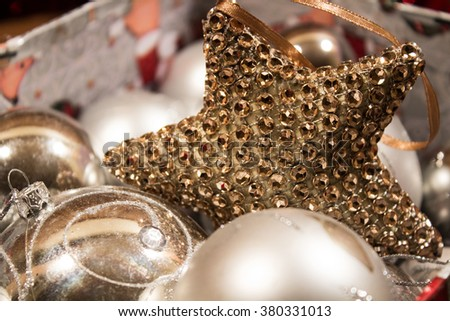 Christmas balls decorations in  gift box. Silver. Gold star . Background