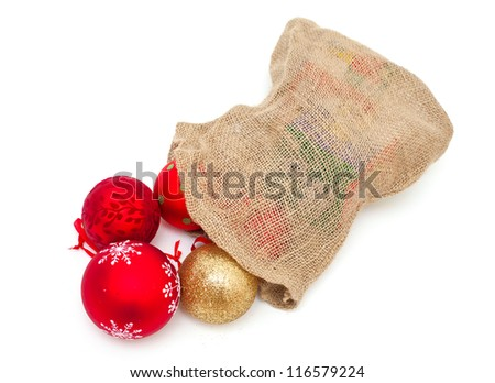 Christmas balls falling from the burlap bag - stock photo