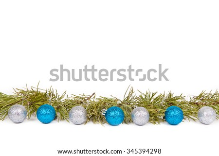 Christmas balls green branches of a Christmas tree on a white background. The concept of the new year