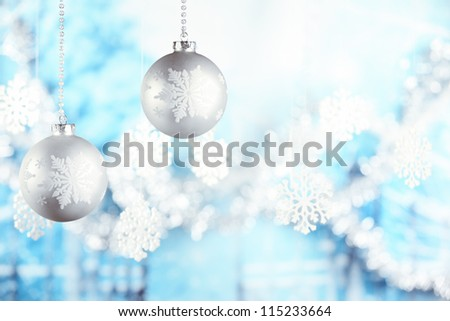 Christmas balls hanging on blue background - stock photo