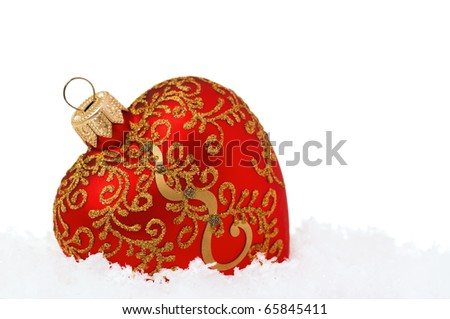 Christmas balls-heart on snow on white background