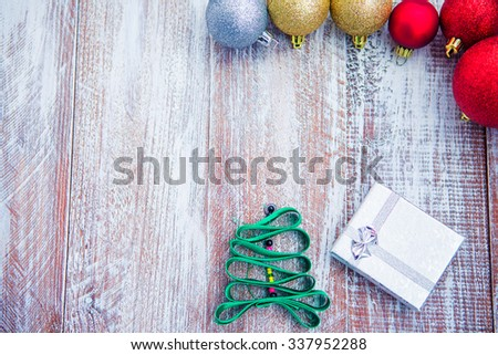 christmas balls isolated on a wooden background - stock photo