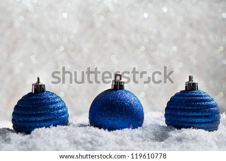 christmas balls on abstract light background - stock photo