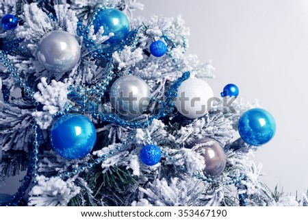Christmas balls on fir tree. Blue and white. New Year holidays and Christmastime celebration