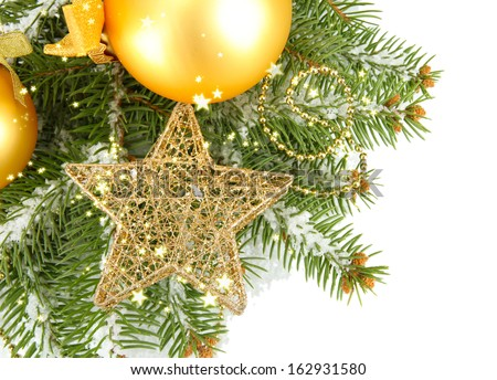 Christmas balls on fir tree with snow, isolated on white - stock photo