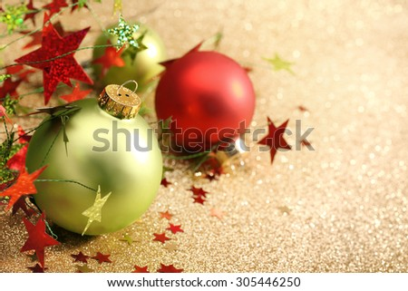 Christmas balls on golden background - stock photo