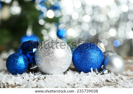 Christmas balls on grey wooden background