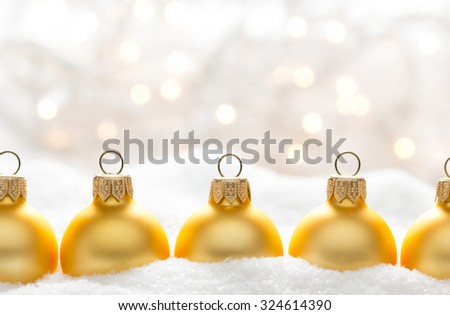 Christmas balls on snow - stock photo