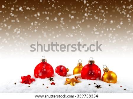 Christmas balls on the snow - stock photo