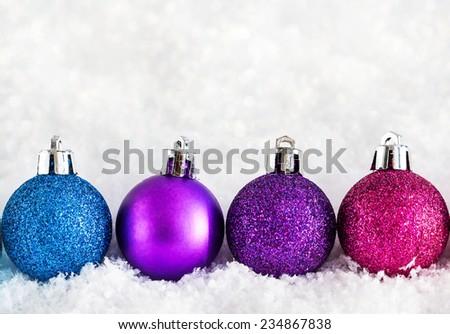 Christmas balls on the snow background - stock photo