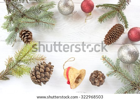 Christmas balls pine cones, needles on wooden background