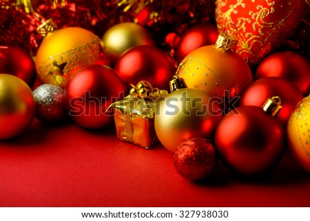 Christmas balls red and gold on blurred background new year - stock photo