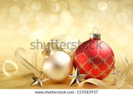 Christmas balls with ribbon on abstract background