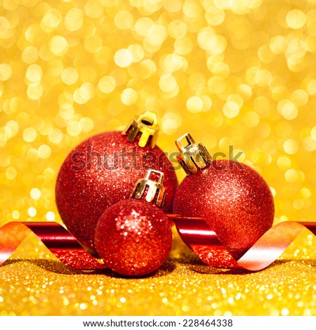 Christmas balls with ribbon on abstract background. studio shot - stock photo