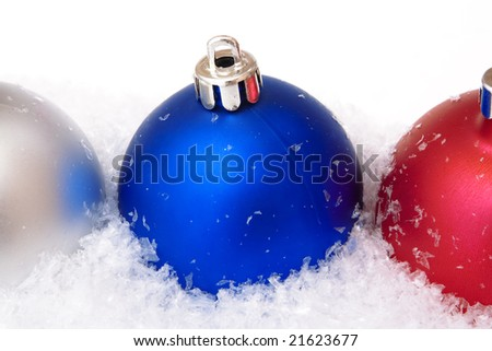 Christmas balls with snow isolated on white